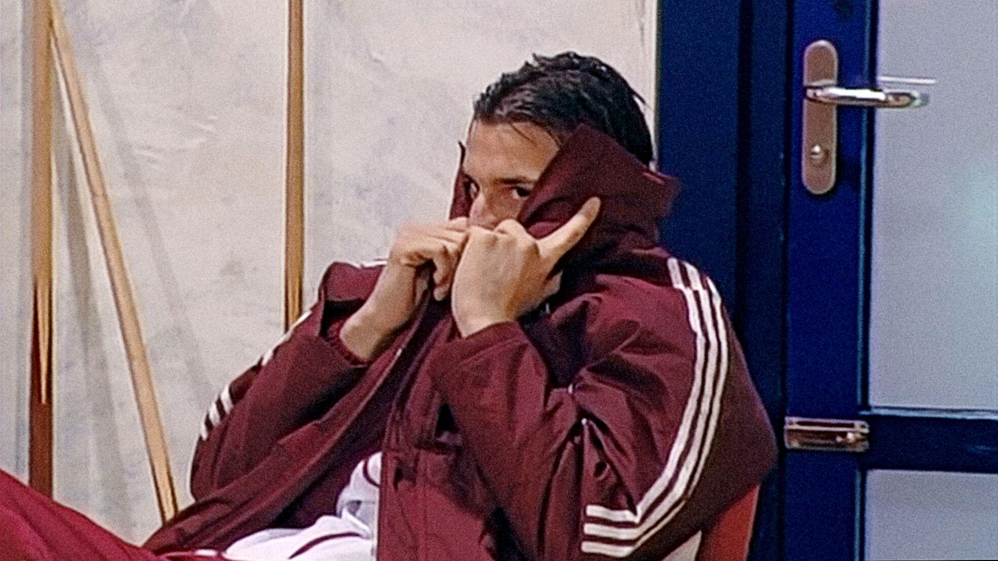 Teenage Zlatan hiding behind his jacket at Ajax
